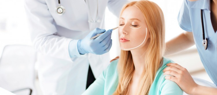 male plastic surgeon with patient